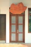 Wooden door with glasses Stock Photo
