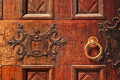 Wooden door with golden handle. Royalty Free Stock Photos