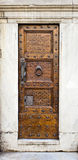 Wooden door, Gothic style, Florence. Royalty Free Stock Images