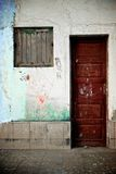 Wooden door and graffiti Stock Images