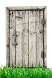 Wooden door with grass isolated on a white background Royalty Free Stock Images