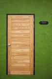 Wooden door on green Stock Image