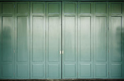 Wooden door with green color and background Stock Photo