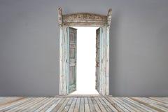 Wooden door in grey color room with wooden flooring Stock Images