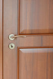 Wooden door with a handle Stock Photo