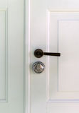 Wooden door with handle. Stock Photos