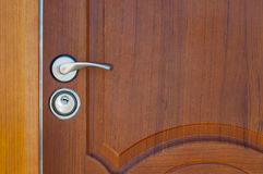 Wooden door handle and lock Royalty Free Stock Photography