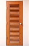 Wooden door with handle Stock Photo