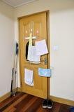 Wooden door. Hanging towels in home Royalty Free Stock Photo