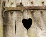 Wooden door with heart. Wooden door with black heart Stock Photos