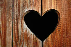 Wooden door with heart Stock Image