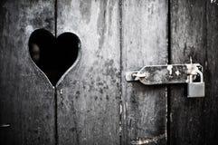 Wooden door with heart Stock Photos