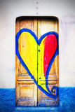 Wooden door with heart painted Stock Photography