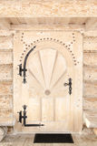 Wooden door with a highland cottage Royalty Free Stock Photo
