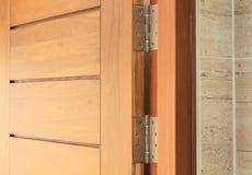 Wooden door with hinge Stock Photos