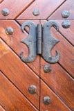 Wooden door hinge Stock Images