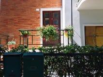 Wooden door of a house - Building façade. Pesaro, Italy stock images