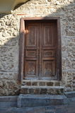 Wooden door in a house built of of stone Stock Image