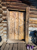 The Wooden door in house and footwear Stock Photography