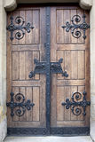 Wooden door with iron details Royalty Free Stock Image
