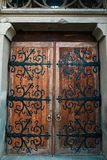 Wooden door with iron forging, vintage wooden antique door with wrought iron curtains and insulated intersection royalty free stock photos