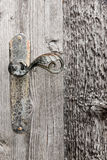 Wooden door with iron handle. Stock Photos