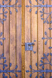 Wooden door with ironwork Stock Photos