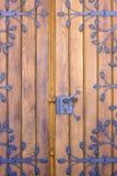 Wooden door with ironwork Stock Photos