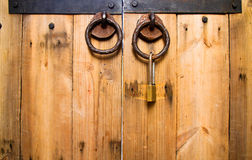 Wooden door knob locked Royalty Free Stock Photo