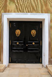 Wooden door with knob in the shape of brass lion, Monaco Stock Photos