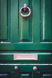 Wooden Door with knocker and letterbox stock photography