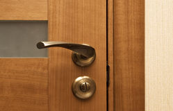 Wooden door with the lock. Real photo close-up royalty free stock image