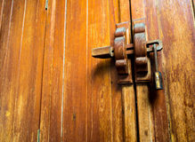 Wooden door and lock at the handle Royalty Free Stock Photography