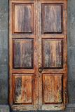 Wooden door with lock and knocker royalty free stock photography