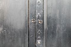 Wooden door with lock and knocker royalty free stock photo