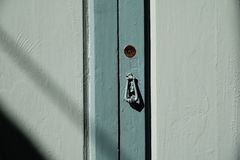 Wooden door with lock and knocker stock images