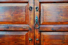 Wooden door with lock and knocker royalty free stock photos