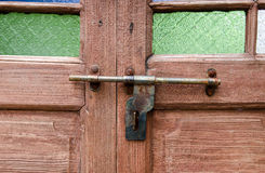 Wooden door with lock. In vintage style Stock Photography