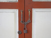 Wooden door locked by master key Stock Images