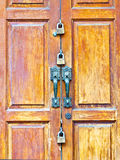 Wooden door with locks Stock Photography