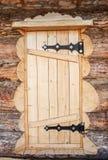 Wooden door of log house Stock Photo