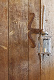 Wooden door made of barn wood with rustic vintage candle lamps Royalty Free Stock Image