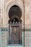 Wooden door in a Madrassa, Fez, Morocco Royalty Free Stock Photos
