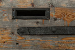 Wooden door with mail slot Royalty Free Stock Images