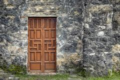 Old Door and Older Wall - Spanish Mission stock photography