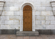 Wooden door, marble slabs. royalty free stock photos