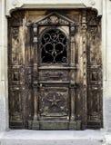 Wooden Door. Massive wood door antique sculpted Royalty Free Stock Image