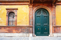 Wooden door of medieval house in Ferrara, Stock Image