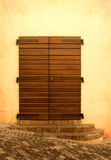 Wooden door with medieval steps. In Italy stock photography