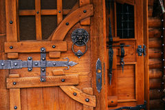Wooden door with metal antiquity forging.  Royalty Free Stock Photos